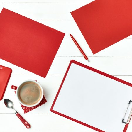 office-table-desk-with-set-of-colorful-supplies-PQFNSHD